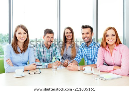 Portrait of a group of young casually dressed professionals - stock photo