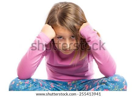 Portrait of a grumpy little girl - stock photo