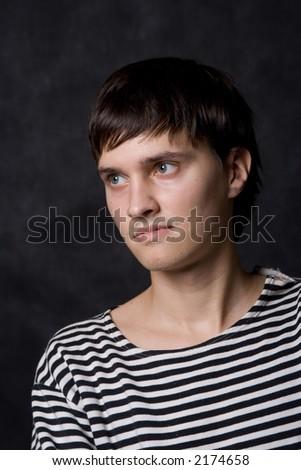 Portrait of a guy in striped vest - stock photo