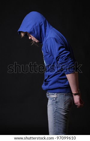 Portrait of a handcuffed - stock photo