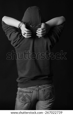 Portrait of a handcuffed. black and white - stock photo