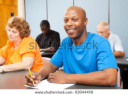 Portrait of a handsome African-american college student in adult education class. - stock photo