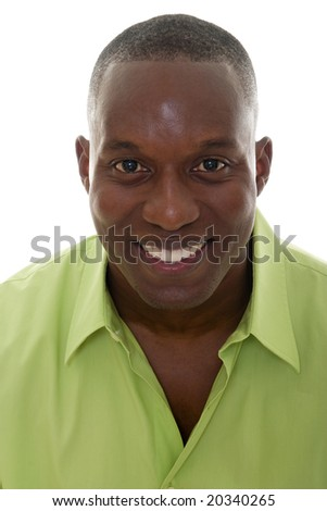 Portrait of a handsome African American man in a bright green shirt and smiling looking directly into the camera. - stock photo