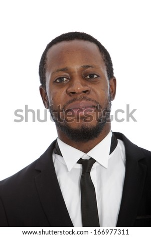 Portrait of a handsome African man in a stylish suit and tie looking directly at the camera with a friendly smile, isolated on white