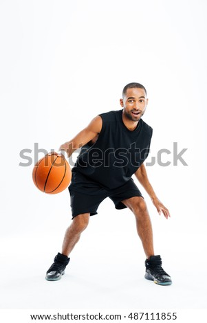 Portrait of a handsome african man playing in basketball isolated on a white background