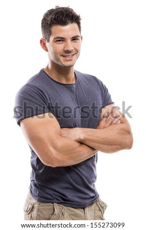 Portrait of a handsome and athletic latin man smiling with hands folded, isolated over a white background - stock photo