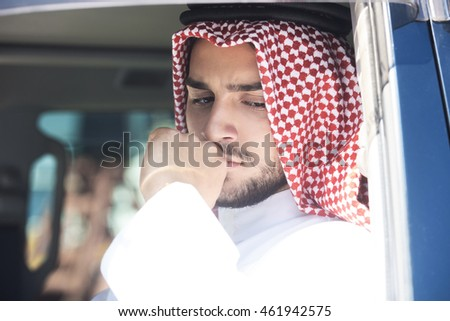 Portrait of a handsome arabian man driving a car