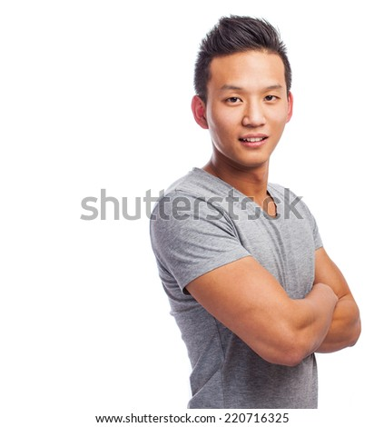 portrait of a handsome asian young man standing - stock photo