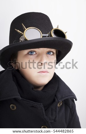 Portrait of a handsome boy closeup steampunk on white background