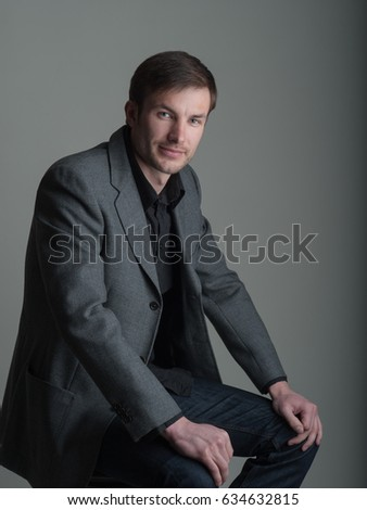 Portrait of a handsome business man on a dark background