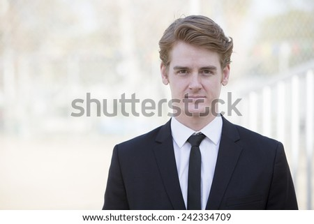portrait of a handsome businessman in a black jacket - stock photo