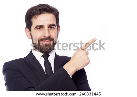 Portrait of a handsome businessman pointing, isolated on white background - stock photo