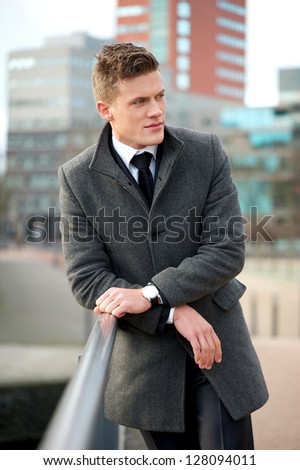 Portrait of a handsome businessman standing outdoors - stock photo