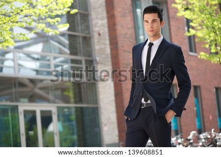 Portrait of a handsome businessman walking to work - stock photo