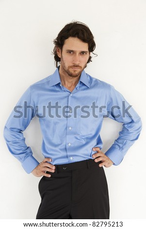 portrait of a handsome businessman wearing blue shirt - stock photo