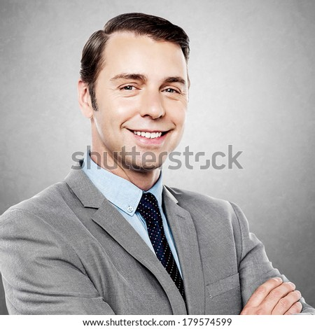 Portrait of a handsome cheerful confident businessman - stock photo