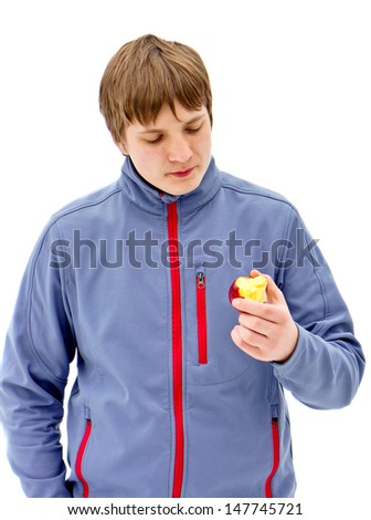 Portrait of a handsome guy in a  jacket, eating apple. Blond hair. White background - stock photo