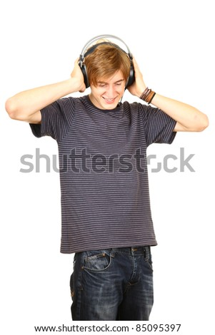 portrait of a handsome guy listening to music on headphones isolated on white background - stock photo