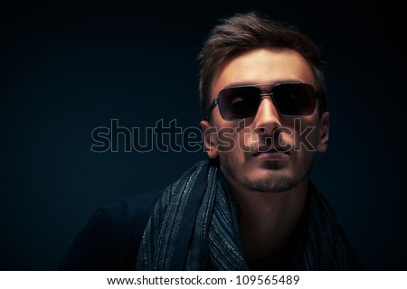 portrait of a handsome guy, wearing sunglasses - stock photo