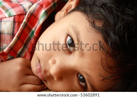 Portrait of a handsome Indian boy - stock photo