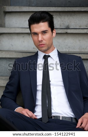Portrait of a handsome male fashion model posing outdoors - stock photo