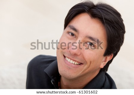 Portrait of a handsome male smiling indoors - stock photo