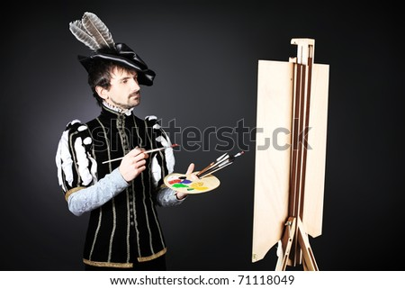 Portrait of a handsome man artist in 16th century costume. Shot in a studio. - stock photo