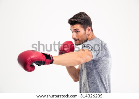 Portrait of a handsome man boxing isolated on a white background - stock photo