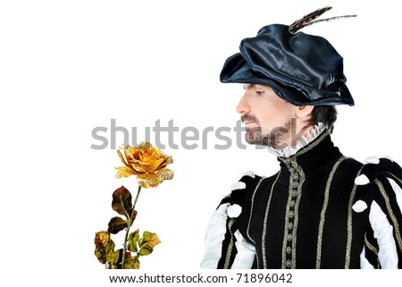 Portrait of a handsome man grandee in 16th century costume holding golden rose. Isolated over white background. - stock photo