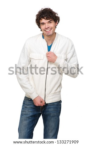 Portrait of a handsome man holding zipper on jacket - stock photo