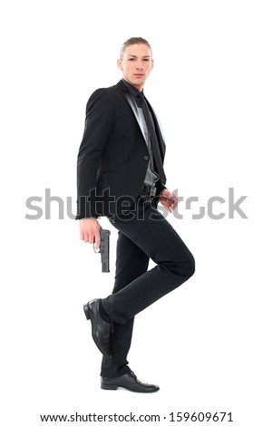Portrait of a handsome man in a suit with a beard who is posing over a white background
