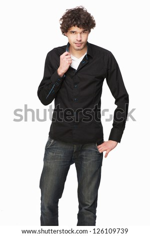 Portrait of a handsome man in black shirt - stock photo