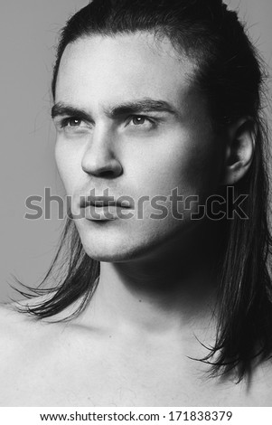 Portrait of a handsome man in studio, Black and white photographs, close-up - stock photo