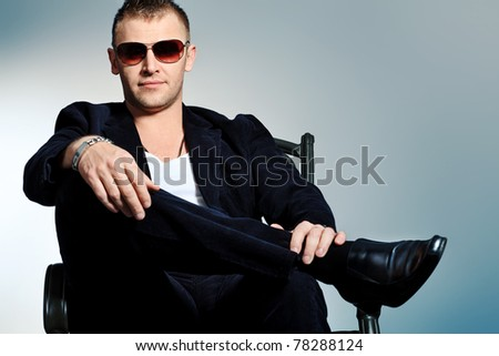 Portrait of a handsome man in sunglasses. Studio shot. - stock photo