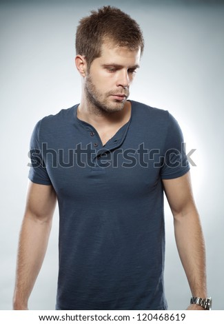 Portrait of a handsome man looking down - stock photo