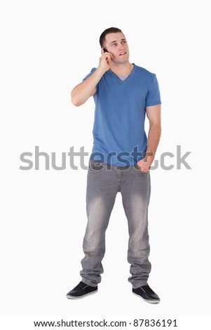 Portrait of a handsome man making a phone call against a white background - stock photo