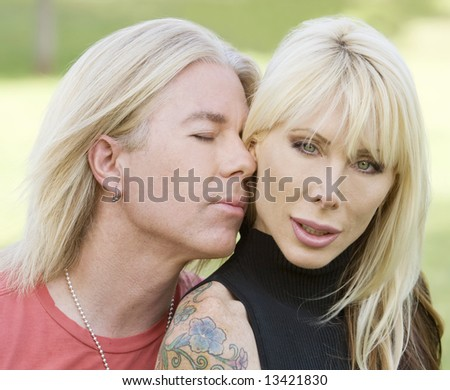 Portrait of a handsome man nuzzling up against a beautiful woman