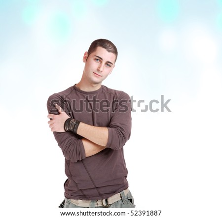 portrait of a handsome man on abstract studio background - stock photo