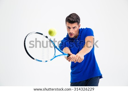 Portrait of a handsome man playing in tennis isolated on a white background - stock photo