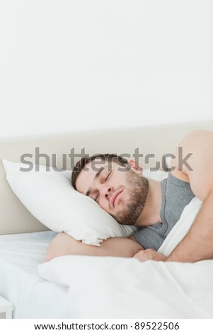 Portrait of a handsome man sleeping in his bedroom - stock photo