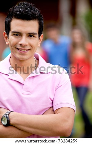 Portrait of a handsome man smiling outdoors