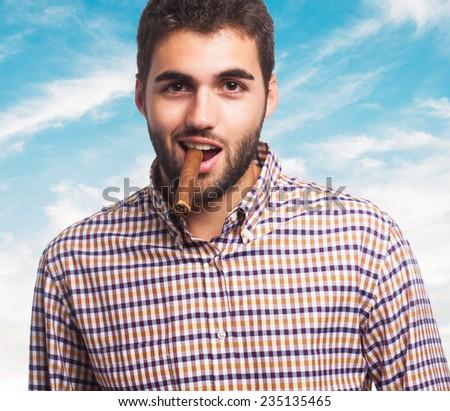 portrait of a handsome man smoking a cigar - stock photo