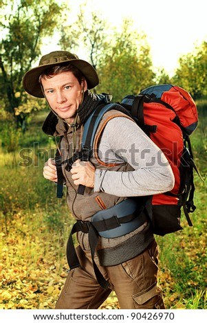 Portrait of a handsome man tourist posing outdoor. - stock photo