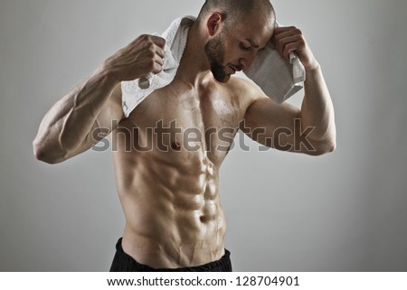 Portrait of a handsome man with a perfect body - stock photo