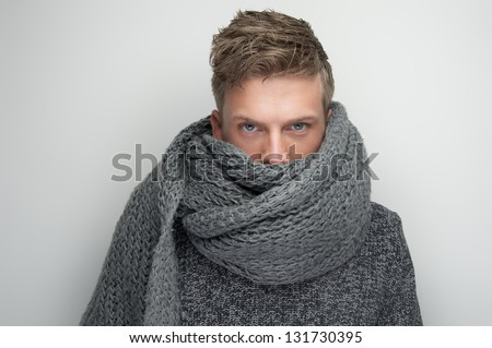 Portrait of a handsome man with face covered by scarf - stock photo