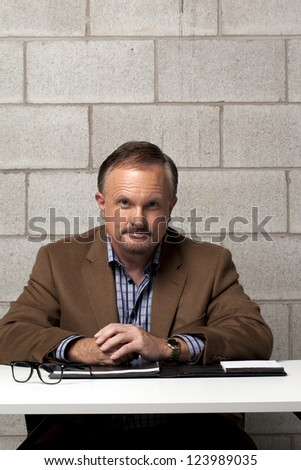 Portrait of a handsome mature businessman sitting at his desk