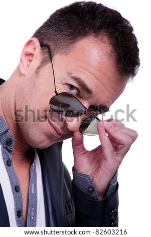 Portrait of a handsome middle-age man with sun glasses, on white background. Studio shot - stock photo