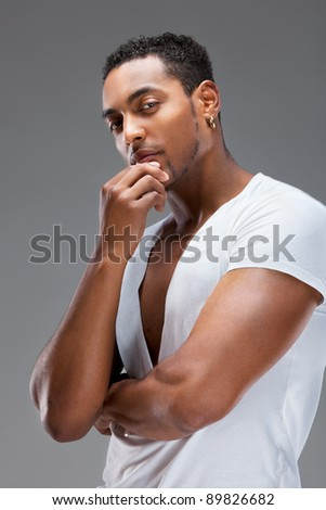 Portrait of a handsome muscular man - stock photo