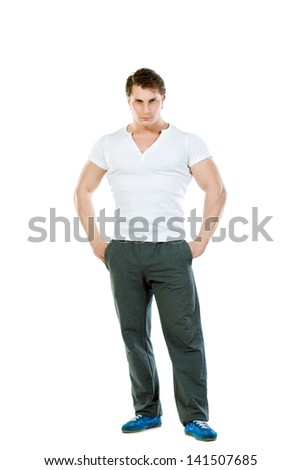 Portrait of a handsome muscular young man. Isolated over white background. - stock photo