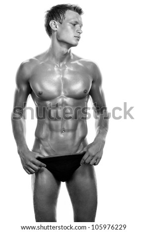 Portrait of a handsome muscular young man. Shot in a studio - stock photo